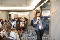 Co-Founder of Run for Something, Amanda Litman speaks to a room of female leaders.