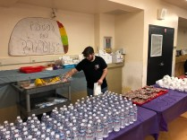 Junior, Drew Michaud-Goetz helps serves chips and salsa at the Tacos for Paradise fundraiser