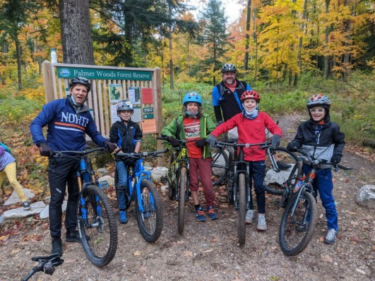 Mountain Bike Team posing at the Palmer Woods' trailhead.