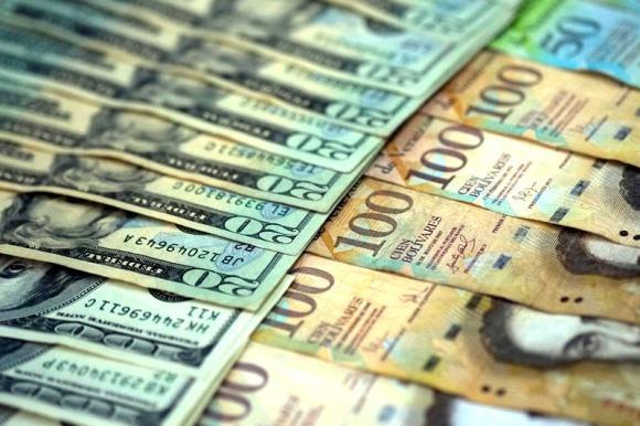 Moneda-Extranjera-Billetes-Bolivares-Dolares-SICAD-CADIVI-Control-de-Cambio-en-Venezuela-800x533