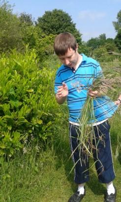 Terry enjoying a spot of grass picking