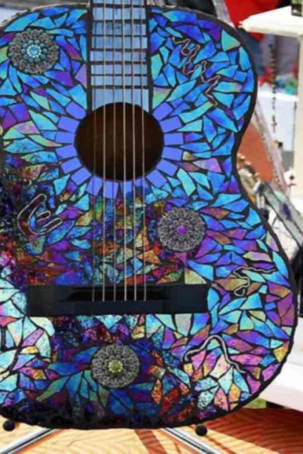 Guitarra con CDs
