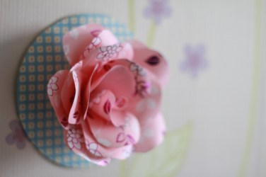 Handmade paper rose by R. Love it in a million ways.