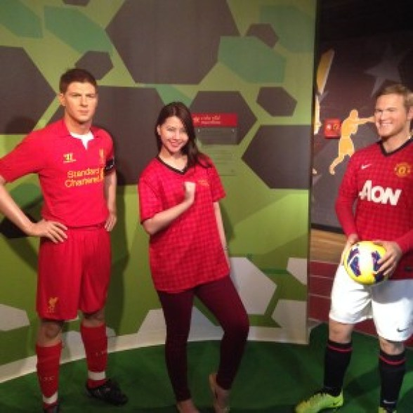 Me playing in the World Cup with some of their best foot ball players :) Hehe. (Taken at Madame Tussauds)