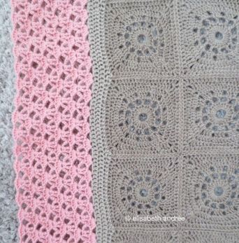 beige blanket with pink edge