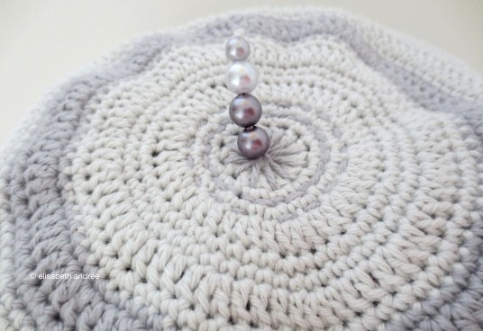 cuddle cushion 2 shades of grey with beads