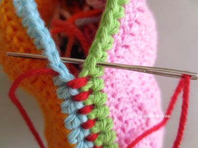 sewing last stitches of toy for dog