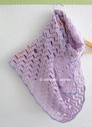 crochet lacy and lilac scarf on hanger