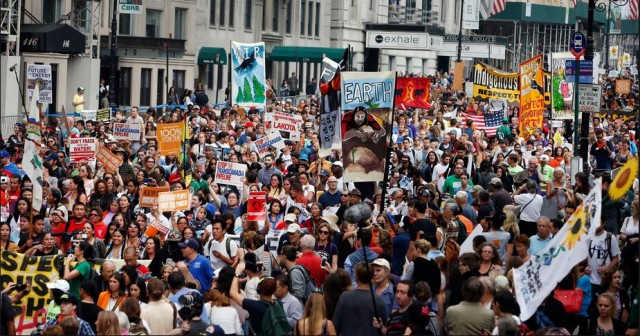 """Nobody cares about climate change?"" Think again. On Sept. 21 400,000 people showed up just in New York City for People's Climate marches around the world."