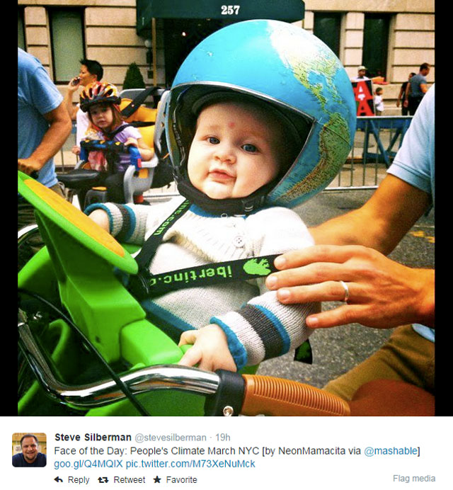 Photo People's Climate March: NYC: Baby with globe as bike helmet.
