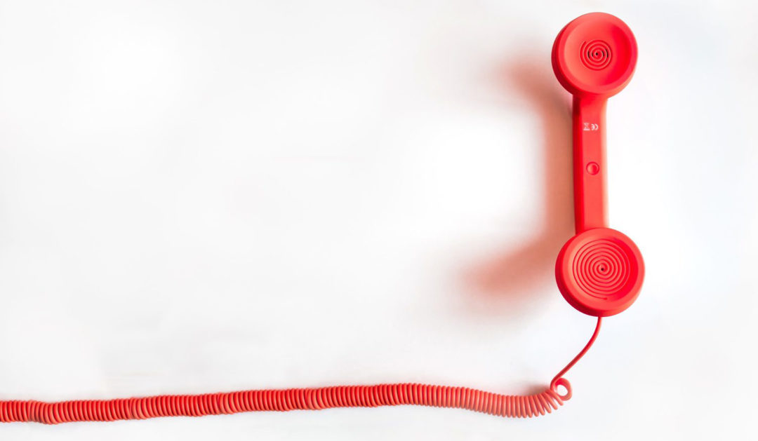Contact Me - photo of red phone receiver and cord.