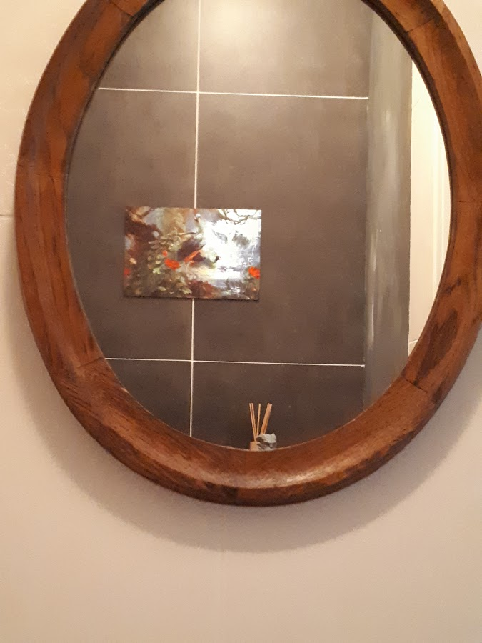 Onze wanddecoratie - spiegel wc