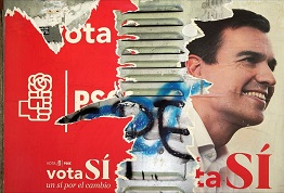 A poster showing PSOE leader Pedro Sanchez is seen in Madrid