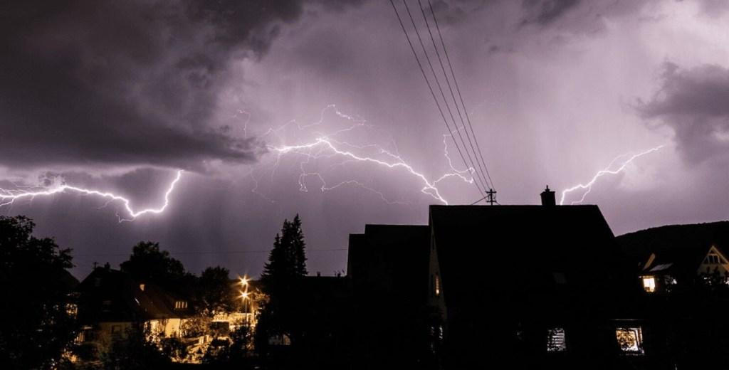 Lightning over houses