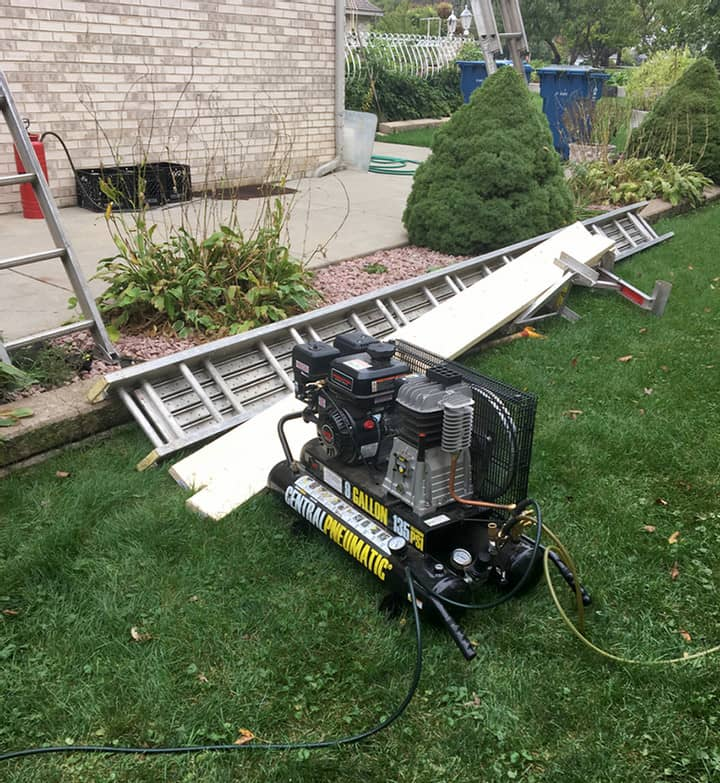 generator being used during a roof install job site