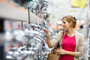 woman looking at faucets