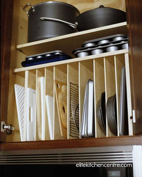Organize lesser-used trays and bakeware in the cabinet above your fridge.