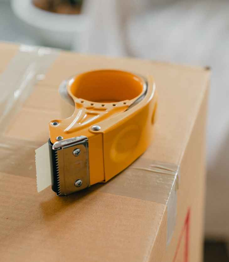 packing tape gun on carton box