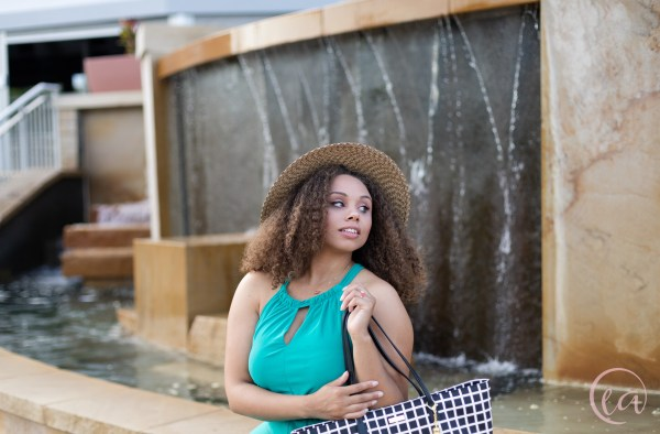 Kaela sits by the fountain on Little Sugar Creek Greenway and looks over her shoulder. Kate Spade shoot by Elizabeth A. Images