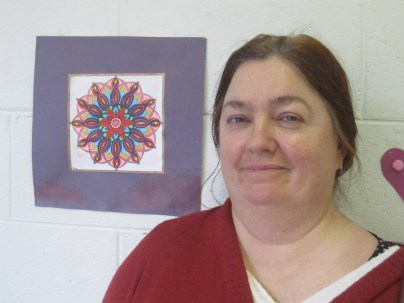 Angela with some of her work