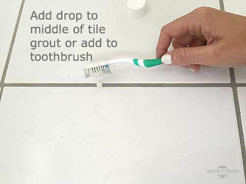 add drop of polyblend snow white #11 to middle of tile grout or add to toothbrush