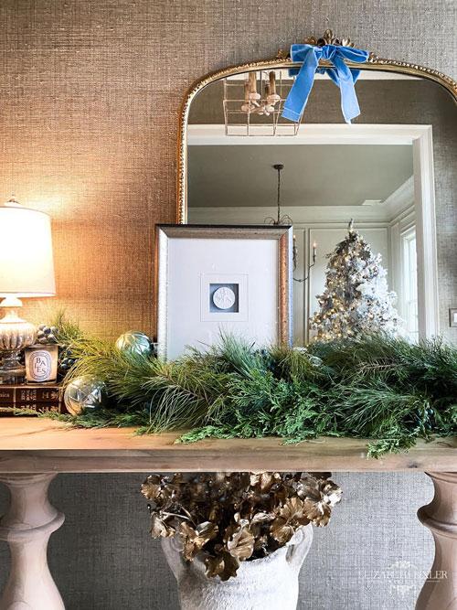 Studio mcgee garland , christmas foyer table, baies candle, intaglio