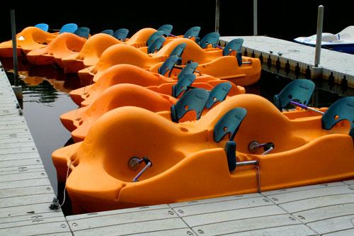 Bright orange boats at pier