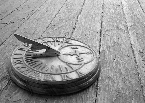 Sundial on wooden porch