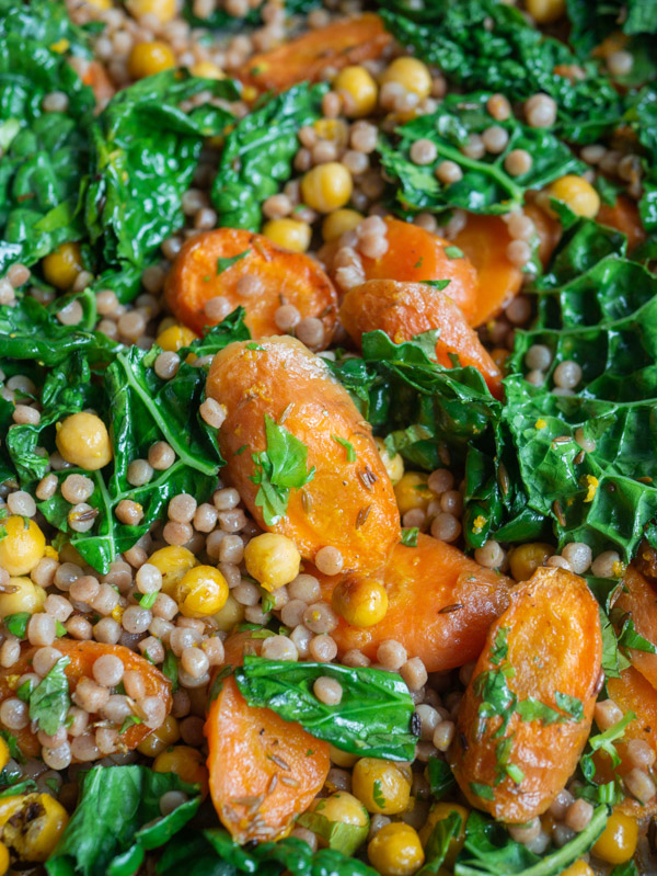 Couscous carrot chickpeas and cavelo nero in a roasting tray