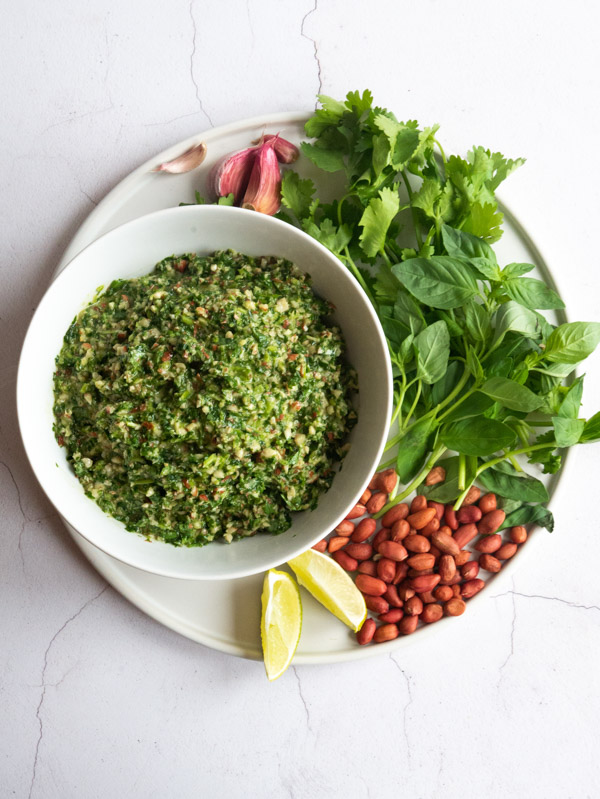 Vietnamese pesto in a bowl with the ingredients on a plate