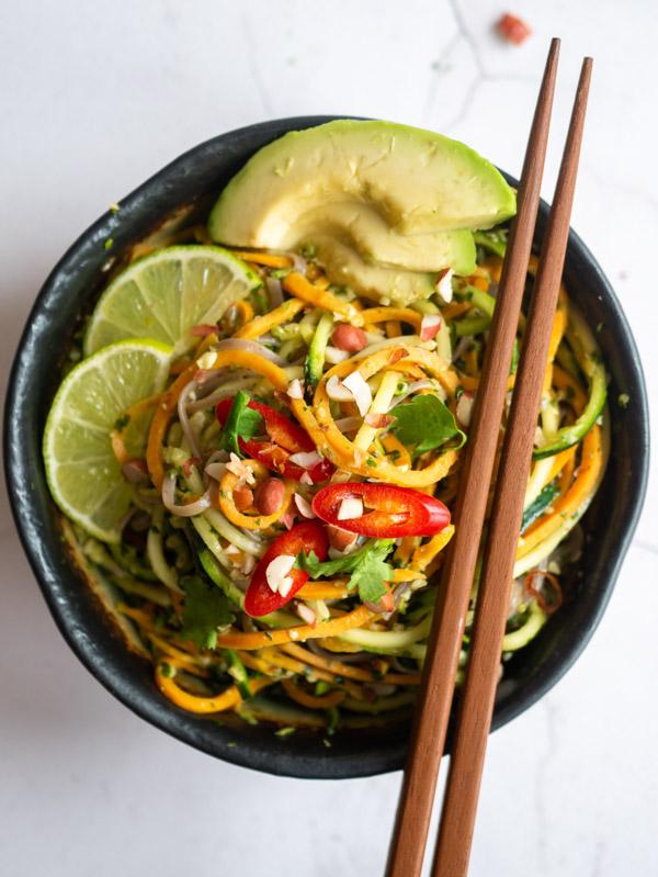 a bowl Vietnamese pesto noodles with chopsticks