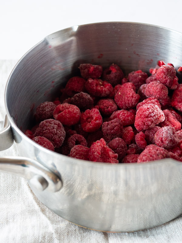 frozen raspberries in a saucepan
