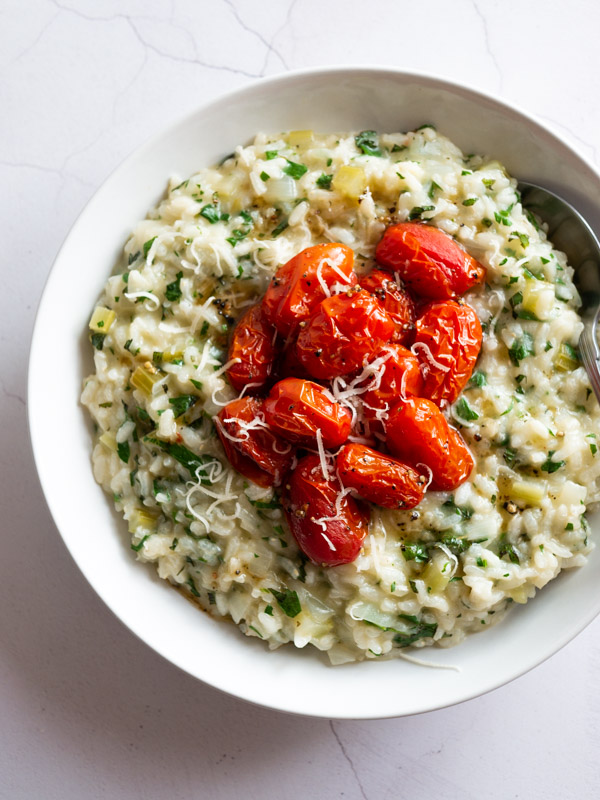 Herby Tabbouleh Risotto with Roast Tomatoes in a bowl with a spoon