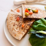 chorizo and vegetable quesadilla on a plate with salad