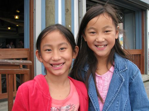 """Sisters happy to be eating at Snoopy's under the Causeway to the island. """"This is so cool, Mom!"""""""