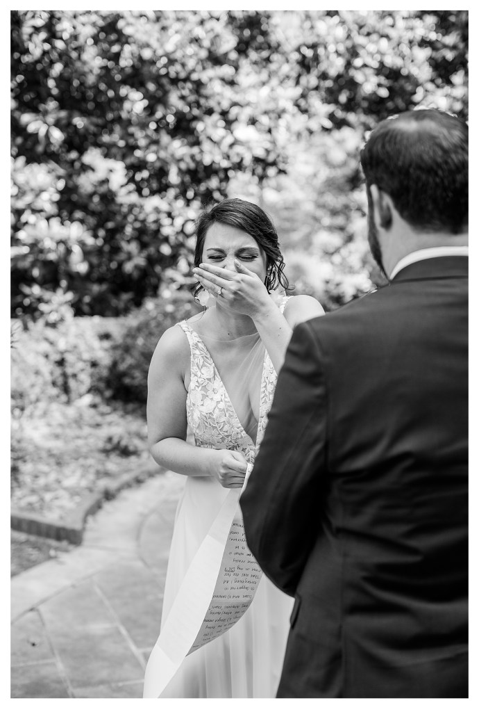 Bride laughing while giving vows