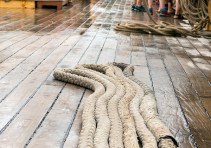 Mooring lines flaked on the deck, ready for use.