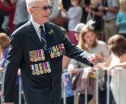 A be-medalled veteran with a big smile.