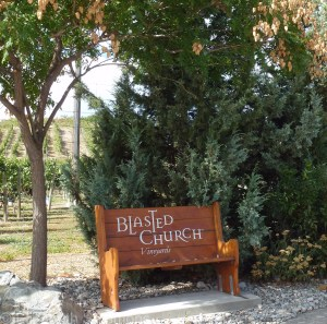 Blasted Church Vineyards takes its name from the church that used to stand on the site. In 1929, its nails were loosened by a controlled dynamite blast, after which the building was dismantled and reassembled 25 km south in Okanagan Falls, where it still stands.