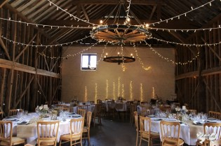 Over Barn styling, wall fairy lights- Elizabeth Weddings