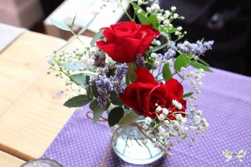 Red, purple and white jam jar flowers- Elizabeth Weddings
