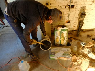 Mixing up the mortar... notice the casually placed mason jar, no pun actually intended! We literally grabbed the first thing on hand to add water to the mix... getting a pretty good chuckle when it occured to us what we'd done! :D