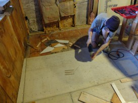 Removing the cement board to rebuild the puzzle.