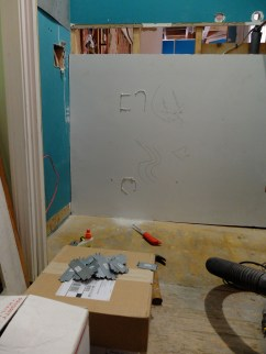 Tracing the cuts for the utility closet wall 2nd floor.