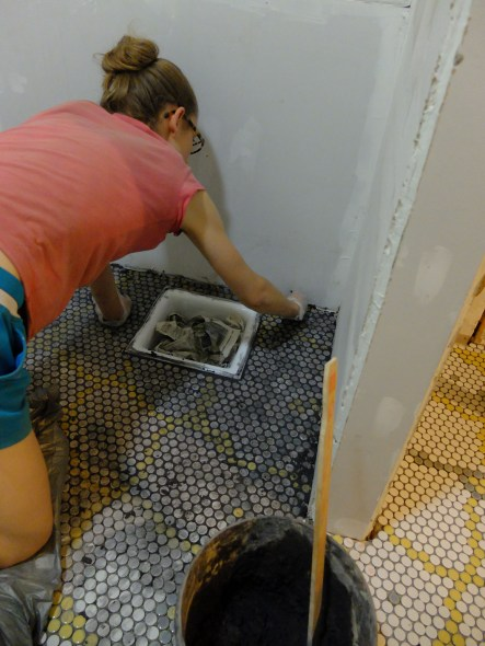 Grouting as we go. We learned the hard way not to let the tiles sit un-grouted for too long!