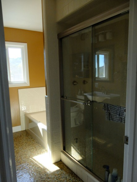 New brushed nickle shower door surround with clear glass panels.
