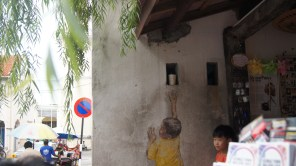 ~Street art, Penang..boy on chair trying to get something..