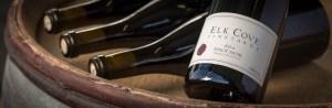 pinot noir bottles on barrel