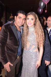 سحر شعراوي ومصمم الأزياء أحمد فايز