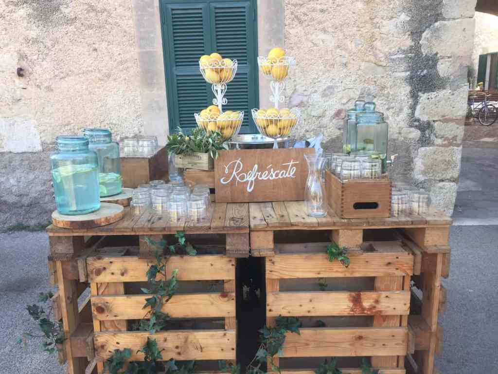 A rustic and refreshing drink stand to welcome your guests to your wedding